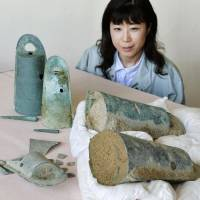 Bell-shaped bronze vessels from the Yayoi Period discovered in Minamiawaji, Hyogo Prefecture, last month are displayed Tuesday. | KYODO