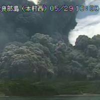 Smoke and debris from the volcanic eruption on Kuchinoerabu Island create a 9-km plume in this image from Kagoshima Prefecture released by the Meteorological Agency on Friday. | KYODO