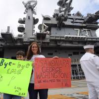 U.S. carrier George Washington leaves Yokosuka after seven years