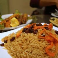 Afghani spice: Rice is topped with juicy raisins and carrots. | ADAM MILLER