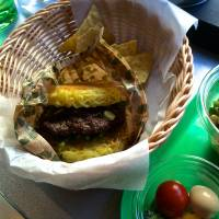 Noodling in: A Ramen Burger set comes with the burger, a New York salad and chips, but the main draw is the ramen patties. | ROBBIE SWINNERTON
