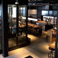 Clear view: The tanks and tuns that brew Spring Valley Brewery's signature suds are on display in the middle of the Daikanyama establishment.  | ROBBIE SWINNERTON