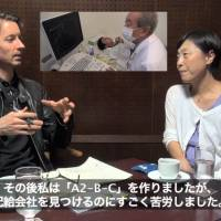 Talking shop: Documentary filmmakers Ian Thomas Ash and Hitomi Kamanaka sat down at the Foreign Correspondents' Club of Japan recently to discuss their craft. Both have produced films about the effects of radiation in Fukushima since the March 2011 nuclear accident. The still image in the background is from Ash's 'A2-B-C.'