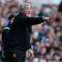 Trying times: Hull City manager Steve Bruce's team must defeat Manchester United on Sunday and hope Newcastle United falls to West Ham to guarantee that it won't be relegated from the Premier League. | REUTERS