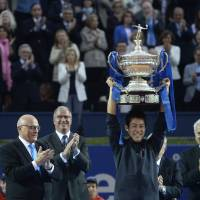 Latest feat: Kei Nishikori lifts the winner's trophy after claiming the Barcelona Open singles title on April 26. | AP