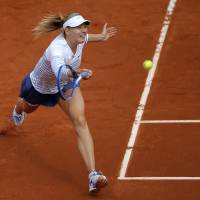 Sharapova, Berdych advance to 2nd round