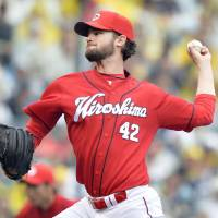 Red Rising: Kris Johnson is off to an undefeated start for the Carp through his first seven outings in Japan. | KYODO