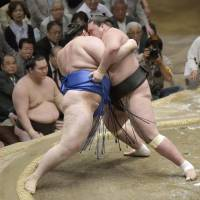 New blood: Terunofuji (right) grapples with Aoiyama on the final day of the Summer Grand Sumo Tournament.   KYODO