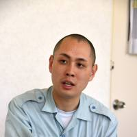 Helping hand: Education official Masatoshi Ishii speaks about his experiences at the Tama Juvenile Training School. | SATOKO KAWASAKI