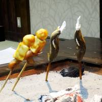 Freshly caught trout and the regional speciality of dekomawashi cook over the embers at Hotel Kazurabashi | MANDY BARTOK