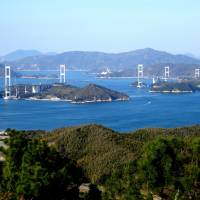 The view from Mount Chikami lookout in Imabari, Ehime Prefecture, reveals the length of Kurushima-Kaikyo Bridge, part of the Shimanami Kaido toll road and the longest suspension bridge in the world. | MANDY BARTOK