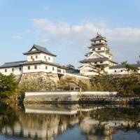 The donjon of Imabari Castle is reflected in its tidal moat. | MANDY BARTOK
