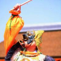 A dancer performs in an animal mask for a bugaku (court) dance. | ANGELES MARIN CABELLO