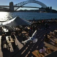 Trouble maker: People eat outside on a sunny autumn day in Sydney on May 12. Australia's Bureau of Meteorology has warned the El Nino weather phenomenon, which can spark deadly and costly climate extremes, will pack a punch this year. | AFP-JIJI