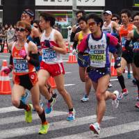 Run for your life: A group of male runners participate in the 2015 Tokyo Marathon. | NAKASHI / CC BY-SA 2.0