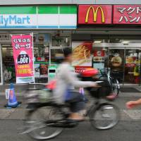 Decisions, decisions: While McDonald's is planning to close and remodel stores and revamp menus to bring back customers, convenience stories are focusing on singles and seniors — two demographics that are booming in Japan right now. | BLOOMBERG