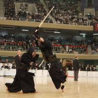 Revered art: Competitors clash at the All Japan Kendo Championship at the Budokan in Tokyo. | COURTESY OF KENDO WORLD MAGAZINE