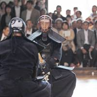 Master of the blade: Saburo Iwadate, who holds kendo's highest rank of Hanshi 8-dan, during a match at the Butokuden in Kyoto.  | COURTESY OF KENDO WORLD MAGAZINE