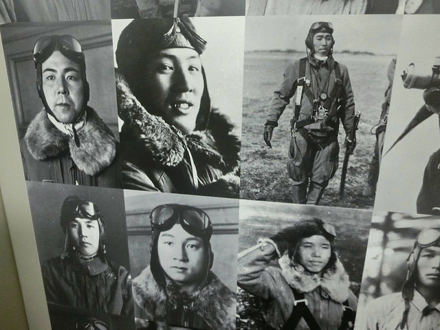 Death awaits: Pictures of kamikaze pilots form part of an exhibition currently being held aboard the USS Missouri in Honolulu.   M.G. SHEFTALL