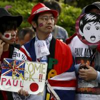 Come together: Fans await the arrival of Paul McCartney to the Nippon Budokan for a concert on April 28. | REUTERS