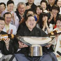 Drink up: Terunofuji celebrates after his victory in the Summer Grand Sumo Tournament on Sunday. | KYODO