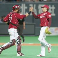 Saving grace: Eagles closer Yuki Matsui (right) and catcher Motohiro Shima have been a solid tandem this season. | KYODO