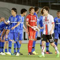 Nice and easy: Gamba Osaka celebrates after their victory over FC Seoul on Wednesday.   KYODO