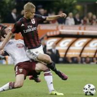 Hungry for more: AC Milan's Keisuke Honda (right) is tackled by Torino's Cristian Molinaro during Milan's 3-0 win on Sunday. | AP