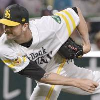 Hawks closer Sarfate savors 100th save in Japan