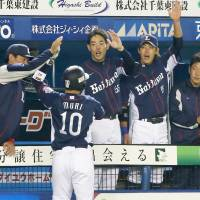 Fired up: Lions players congratulate Tomoya Mori after his solo home run in the third inning against the Marines on Friday at QVC Marine Field. Seibu beat Chiba Lotte 9-3. | KYODO