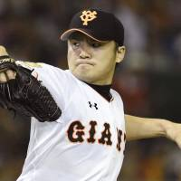 Kanto duel: Giants starter Toshiya Sugiuchi pitches against the Swallows on Saturday at Tokyo Dome. The left-hander worked six innings and improved to 4-1 on the season as Yomiuri defeated Tokyo Yakult 3-2. | KYODO