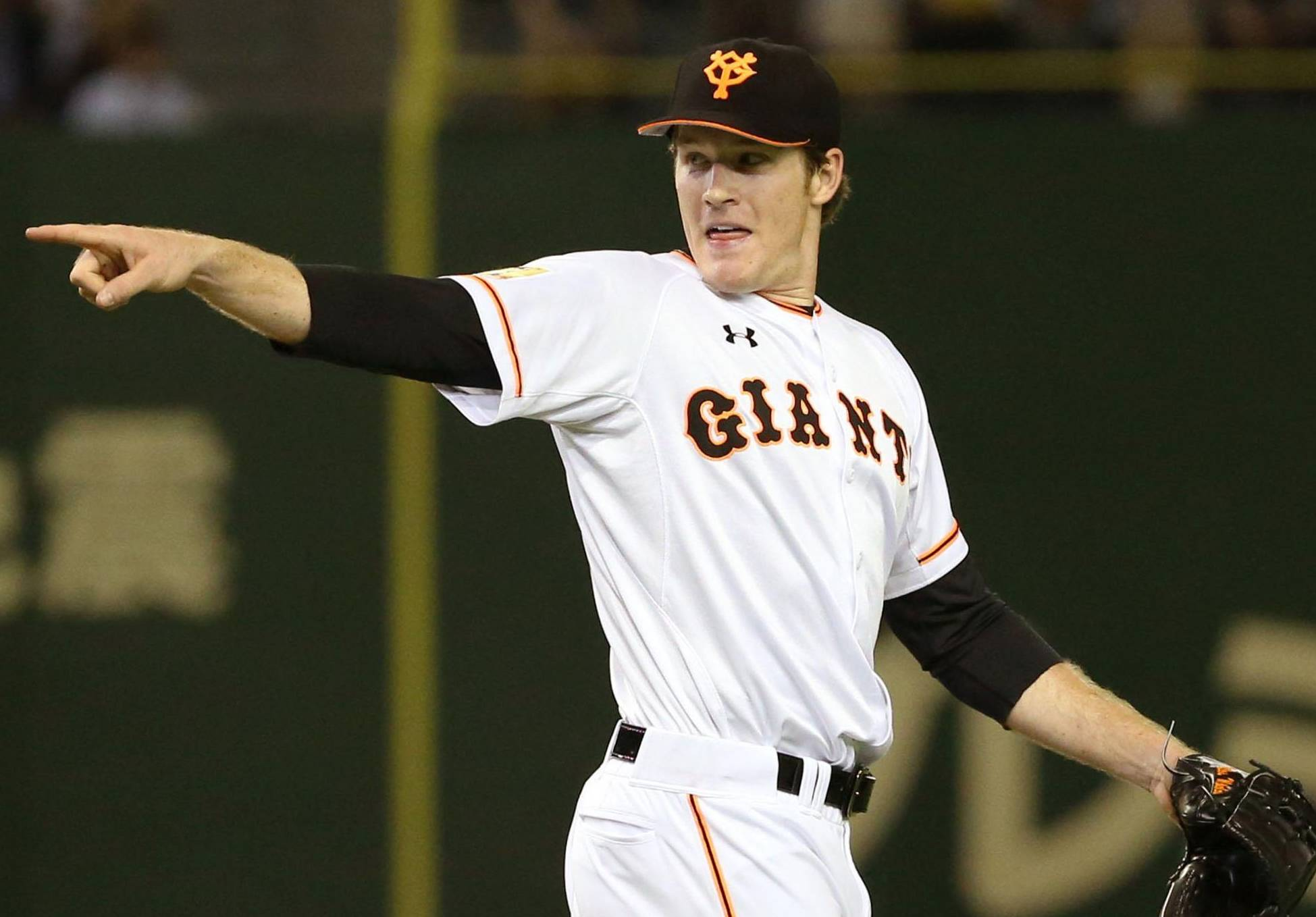 First NPB win: Giants starter Miles Mikolas gestures during Thursday's interleague game against the Lions at Tokyo Dome. The right-hander tossed eight scoreless innings in Yomiuri's 4-1 victory over Seibu. | KYODO