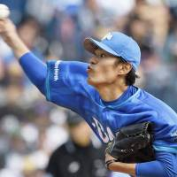 Game face: The BayStars' Shoichi Ino fires a pitch in Saturday's game against the Marines at QVC Marine Field. Yokohama defeated Chiba Lotte 5-1. | KYODO