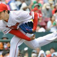 Catch of the day: Carp starter Yusuke Nomura pitches against the Giants during a 4-1 win on Wednesday in Hiroshima. | KYODO