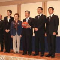 Working together: Newly elected Japan Basketball Association board members, including president Saburo Kawabuchi (with ball), are seen at a Tokyo news conference on Wednesday. | KAZ NAGATSUKA