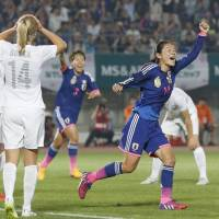 Don't call it a comeback: Homare Sawa (right) wheels away in celebration after scoring in Japan's 1-0 win over New Zealand in Marugame, Kagawa Pref., on Sunday. | KYODO