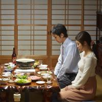 Supper inspection: A father eyes up the way his daughter's boyfriends eat their meals in 'Shabu-Shabu Spirit.'