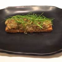 For one of his stellar starters, Meguro pairs foie gras with kegani crab meat, seasons it with konatsu citrus, piles it all onto a base of flaky pastry and garnishes it liberally with chives. | ROBBIE SWINNERTON