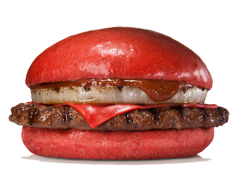 One of Burger King Japan's new burgers, Aka Samurai Beef, comes with red buns and red cheese mixed with tomato powder, a beef patty and onion. | BURGER KING JAPAN
