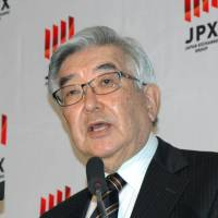 Atsushi Saito, outgoing chief executive officer of Japan Exchange Group Inc., which runs the Tokyo Stock Exchange, speaks during a February news conference at the TSE. | KYODO