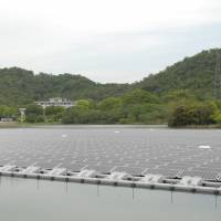 Kyocera's 'mega-solar' station, on floating on the surface of a reservoir in nearby Hyogo Prefecture, uses 9,072 waterproof solar panels.   KYOCERA