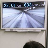 A monitor on an L0 Series magnetically levitated bullet train owned by Central Japan Railway shows it maxing out at 603 kph during a test run in Yamanashi Prefecture in April, setting a new world record. | JR TOKAI / KYODO