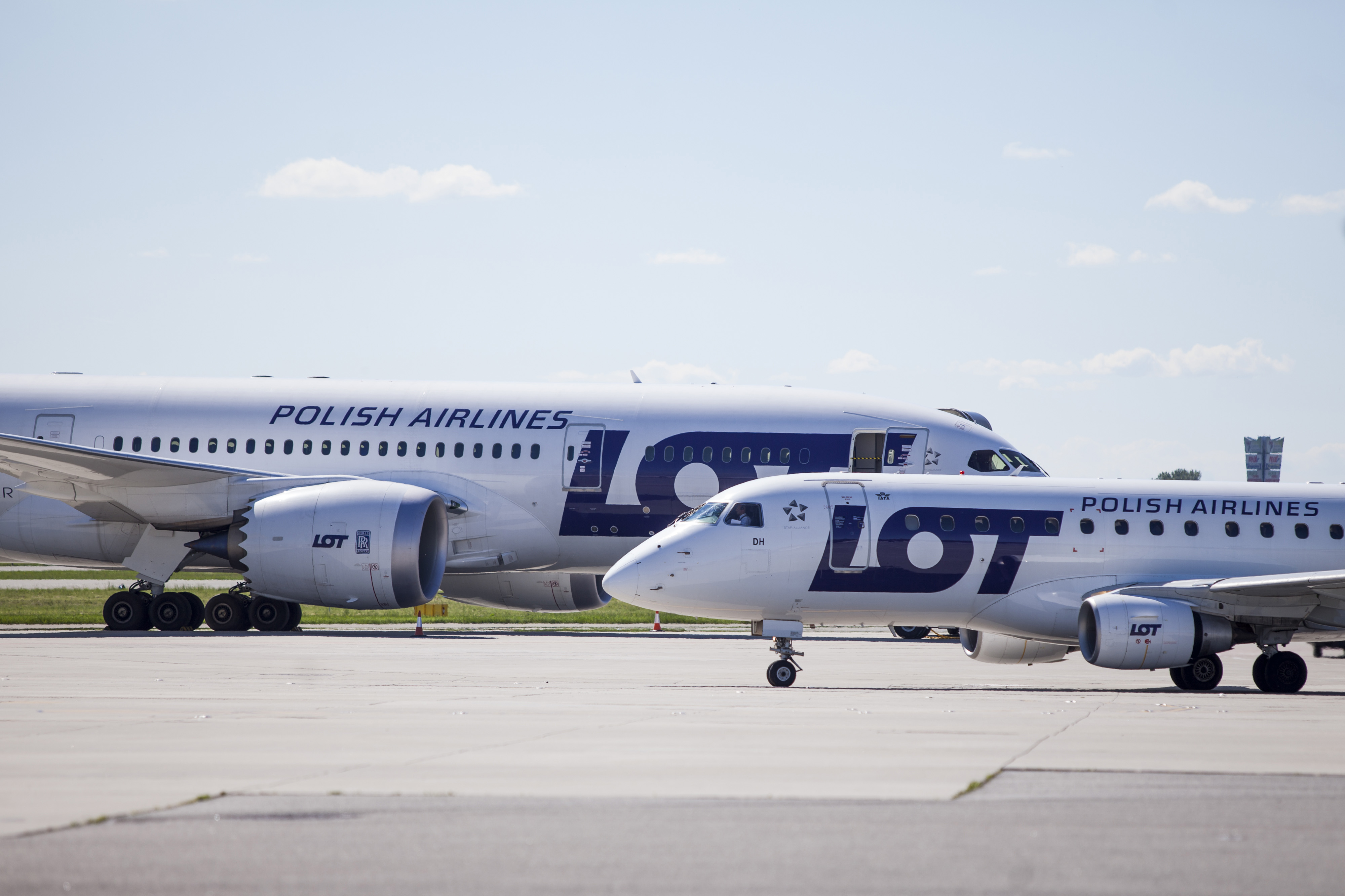 LOT Polish Airlines jetliners sit on the tarmac at Warsaw Frederic Chopin Airport in June 2013.   BLOOMBERG