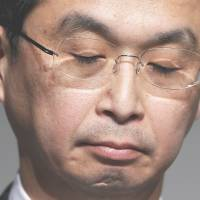 Takata Corp. President Shigehisa Takada makes a rare appearance at a news conference in Tokyo on Thursday as the parts maker gave a briefing on its massive recalls of defective air bags that have led to the deaths of eight people. | REUTERS