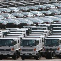 Vehicles await shipment in Yokohama in this 2011 file image. Negotiations on the Trans-Pacific Partnership have been deadlocked for months over Japanese access to the U.S. market and how freely American farm products should compete in Japan. | BLOOMBERG