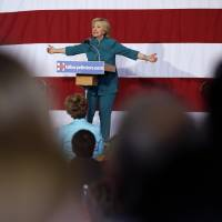 Heed Democrats, change terms on trade pact, Clinton urges Obama