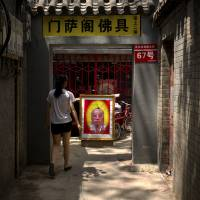 A placard advertises the services of a fortune teller in an alley near the Lama Temple in Beijing. apA sign advertises the services of a fortune teller in an alley near the Lama Temple in Beijing. The former Chinese security czar recently convicted of leaking state secrets shared classified documents with his qigong master. | AP