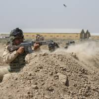 Obama commits 450 more U.S. troops to Iraq, adds Anbar training base