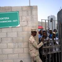 Dominican soldiers control access at the Haitian-Dominican border on Saturday. Dominican authorities set a deadline of June 17 for foreigners who had no residency papers to change their status as part of the National Reorganization Plan for Foreigners. The Dominican government urged the carrying of documents to prove residency, thus avoiding deportation. But thousands of offspring of illegal Haitians who went to the Dominican Republic to work now face eviction, as they are unable to provide the documentation to stay and are not citizens of Haiti, either. | AFP-JIJI