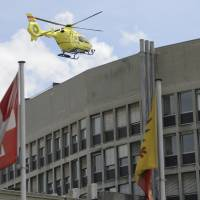 A helicopter takes off at the General Hospital  in Geneva Sunday. Secretary of State John Kerry broke his leg in bike crash outside of Geneva on Sunday and called off the rest of a four-nation diplomatic trip.  X-rays at the Swiss hospital confirmed a fracture of his right femur. Security measures were relieved after the departure of the helicopter but officials did not confirm that Kerry was on board. | MARTIAL TREZZINI/KEYSTONE VIA AP